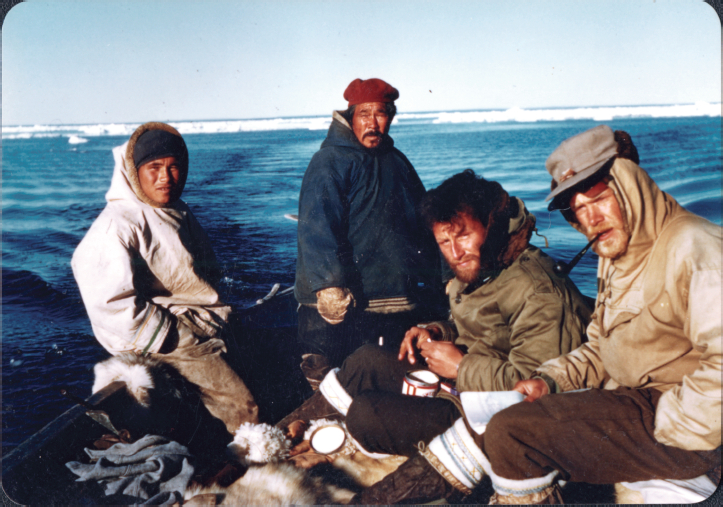 Left to right: Pacome Qulaut, Prime Itikuttuk, Father Louis Fournier, and Jørgen Meldgaard, Igloolik area, 1954. Photographer unknown.