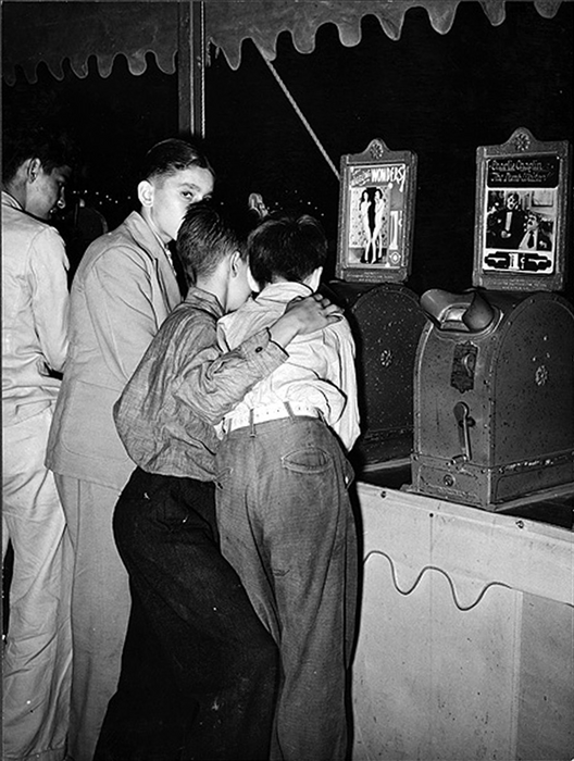 Russell Lee's Boys looking at penny movies at South Louisiana State Fair. Donaldsonville, Louisiana, October 1938.