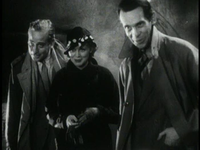 The Old Dark House (James Whale, 1932).Grouped figures bow…