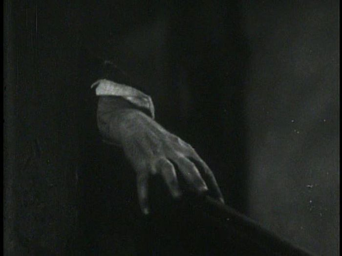 The second shot of Saul's hand on the banister.