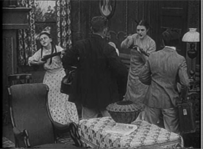 An especially extensive panning movement traverses an entire room in The Farmer's Daughters (1913).