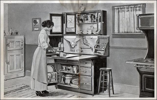 Illustration showing Christine Frederick's new concepts of kitchen efficiency. Note the many areas of functionality within the small work station.