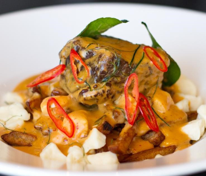 Siam Restaurant Penang Beef Poutine: fries, cheese curds and braised beef topped with a Panang curry sauce. Second place in the Most Creative Montreal category of the 2016 Poutine Week edition.