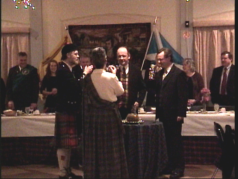 The participants in the ceremony toast the haggis with whisky (L-R: Ean Parsons, piper, Jennifer Whitfield, haggis bearer, Christopher Pickard, Michael Pickard).