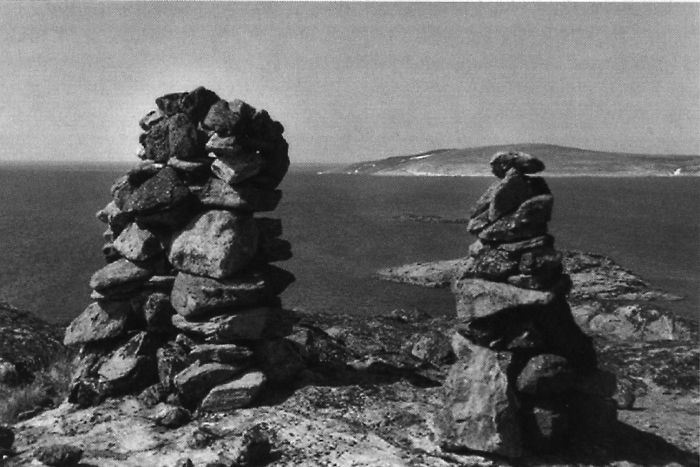 Inuksuit on ridge top near the Inuit village Quaqtaq, Nunavik, 2000.