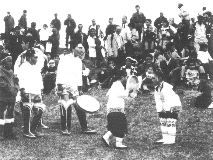 Anna Kuitse, a drum-dance leader and teacher from Kulusuk, and some of her pupils, performing drum dances in traditional East Greenland dress in Tasiilaq, 21 June 2001 (photo by Cunera Buijs, National Museum of Ethnology, Leiden).
