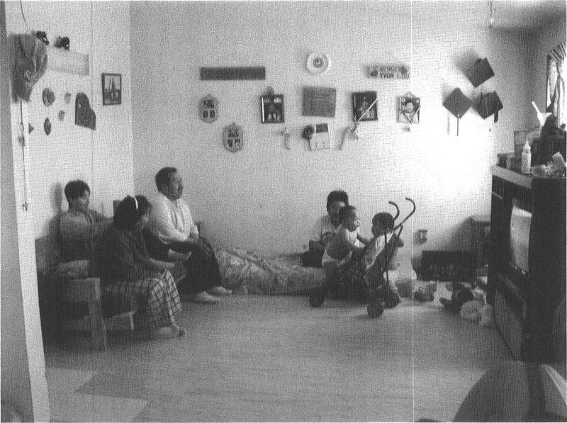Socialising with family members in an Inuit home, Arviat, 2002.