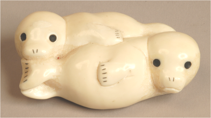 Walrus tusk carving of white coated seals by Lev Nikitin, early 1970s.