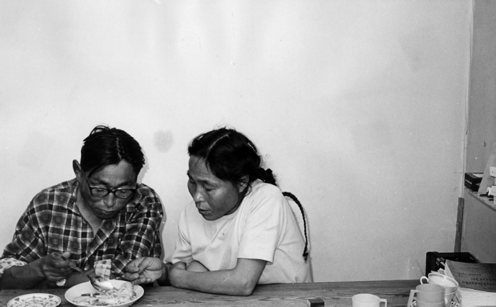 Lars and Asta Jonathansen eating cooked fish from a plate, Diilerilaaq, 1967. Photo: G. Nooter, Museon 67-03-58-10.